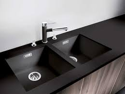 single rectangle black blanco sinks plus black kitchen faucet on black countertop before the window for