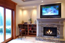 indoor tv above the fireplace where to put the cable box
