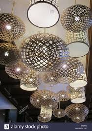 Contemporary Ceiling Light Shades Shiny Silver Metallic Circular Lamp Shades Hanging From A