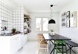 interior fantastic scandinavian kitchen ideas with black rectangle painted wood dining table and white modern floor also small white kitchen cabinet