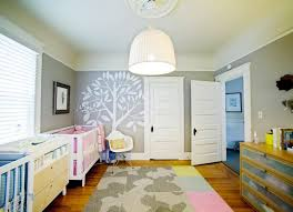 view in gallery nursery with a creative flor tile rug