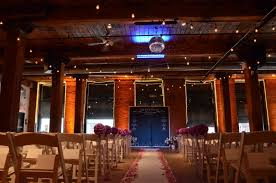 The lighting loft Conversion 200ft Of String Lights Suspended With S14 Bulbs In Zigzag Pattern Under Center Are Of The Main Floor With Uplights The Dumbo Loft Brooklyn Wedding Lighting
