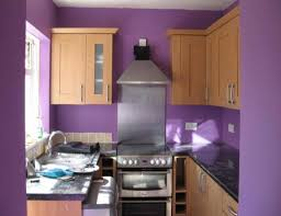 kitchen design purple and white. kitchen brown wooden cabinet and grey granite countertops added by stainless hood purple design white c