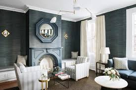 gray striped accent chairs with blue fireplace mantel