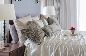a silk comforter and bed skirt really stand out against the rich focal wall remarkably the deep hue highlights rather than overpowers the delicate bedding