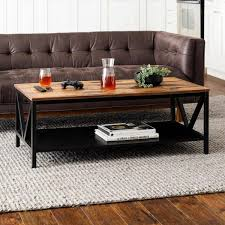 Here is a modern style coffee table with a touch of rustic outdoor tones. Welwick Designs 48 In Brown Black Large Rectangle Wood Coffee Table With Shelf Hd8007 The Home Depot