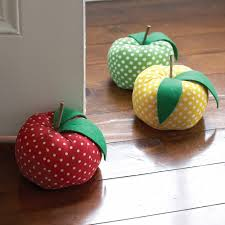 Door stopper shaped like a plush apple Polka-dot fabric with 3 color  choices: green, red, and yellow Heavy weight lb.) stops almost all doors  Size: dia. x ...