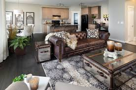 brown leather chesterfield sofa in a designer living room mirrored trunk coffee tables and side