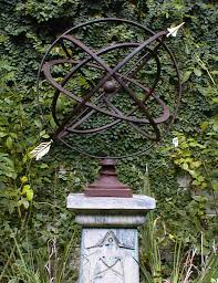 large armillary sphere garden art in many colors