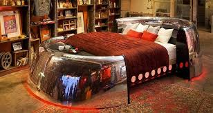One of the coolest beds I've ever seen. Made from found wood