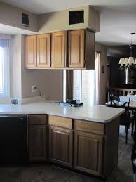 Paint Wooden Kitchen Cabinets Leigh Updates Her Oak Kitchen Cabinets With Caromal Paints