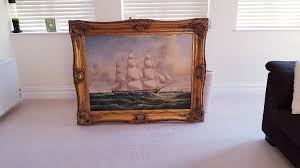 large ornate gilt wood frame with painting