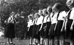 iama i was a german child during wwii that was in the hitler she wore a white blouse a dark blue skirt and a necktie type thing around her neck i googled a picture to show you