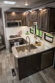 photo of heartland cyclone toy hauler u shaped kitchen