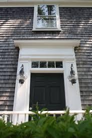 weathered cedar shakes and paired hanging lanterns black front doorscape cod stylegreen doorterior lightingexterior