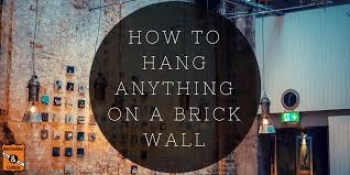 hang anything on a brick wall