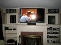 image of perfect mounting tv above fireplace