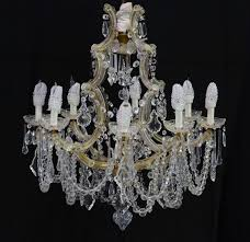 crystal chandelier with gilt metal arm supports 20th century 33in high x 26in in