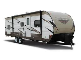 forest river wildwood travel trailer against a blank background