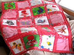 Baby's Cot Quilt by Quilt Affair & baby's cot quilt with red squares each containg different animals Adamdwight.com