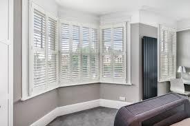 bay window shutters by plantation shutters ltd london