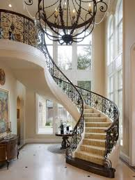 Elegant Staircase in Foyer. The iron rails are pretty