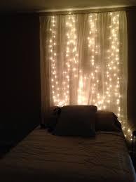 headboard lighting. string lights behind sheer curtain headboard lighting