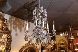 beautiful nine light crystal chandelier having beaded accents on the arms and g cers
