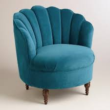 Sumptuous blue velvet covers our clamshell-back chair for an elegant,  vintage-inspired
