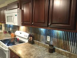 Rustic backsplash from reclaimed tin roofing