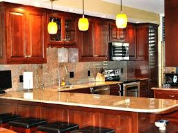 cherry cabinets with quartz countertops kitchen cabinets cherry glass subway tile yelp cherry cabinets with black