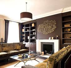 Chocolate brown walls and deep gold metallics bring a lush, warm ambiance  to a living room. Here, a velvet sofa with brown framework and brass nail  heads ...