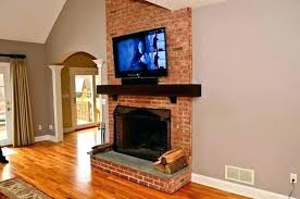 mounting tv above fireplace mounting over fireplace wall installing tv wall mount over brick fireplace install