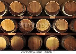 stacked oak barrels. Stacked Oak Wine Barrels In Winery Cellar A