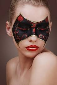 artistic black and red masquerade make up mask with gold glitter and red crystal accents