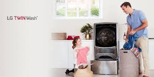 washing clothes in washing machine. wash two loads at the same time washing clothes in machine h