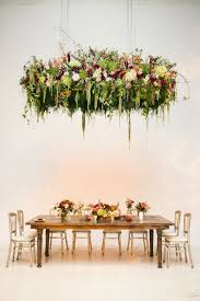 1 this hanging garden 13 photos that prove you need hanging centrepieces at your event greenery hanging arrangement create blooming fl chandeliers