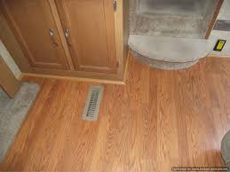 installing laminate flooring in a travel trailer installed quarter round by step