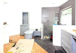 average cost of installing bathroom in basement toilet rough bathrooms pump system plumbing up flush downstairs