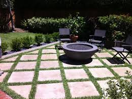 outdoor fire pit with concrete grass