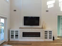 Fireplace Built Ins Mantlemount Tv Over Linear Fireplace Tabby Stucco Beach House