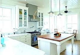 rolling countertop island how to make a butcher block kitchen faucets high are counter top tables