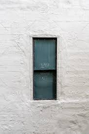 old window in concrete wall painted in white in new york america manhattan nyc new york new york city usa abandoned aged architecture background