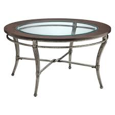 coffee table with glass top in silver and black metal base