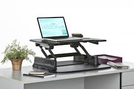 is your back hurting from sitting hunched over at your desk are regarding stand at desk