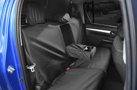 tailored rear seat cover in dark grey for the toyota hilux 2016 on invincible invincible x and icon only 4x4 accessories tyres