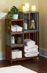 Ordinary wooden crates come together for this attractive and handy bathroom
