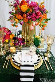 Gorgeous bright colored flowers with black and white striped table runner -  Kate Spade inspired decor