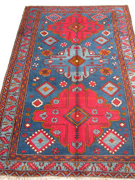 this deep blue red kazak carpet from the caucasus has a beautiful abrash color variation and a rich palette