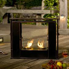 portable indoor or outdoor gel fuel fireplace in sleek black with copper edges and two cans